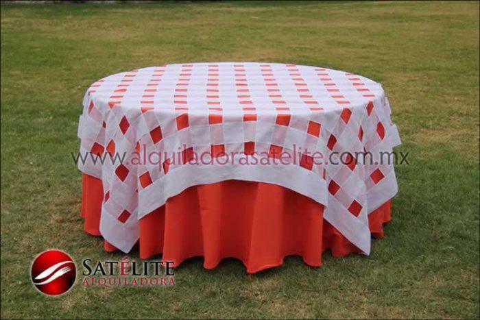 Mantel redondo naranja entrelazado blanco