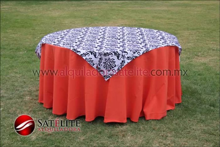 Mantel redondo naranja estampado blanco y negro